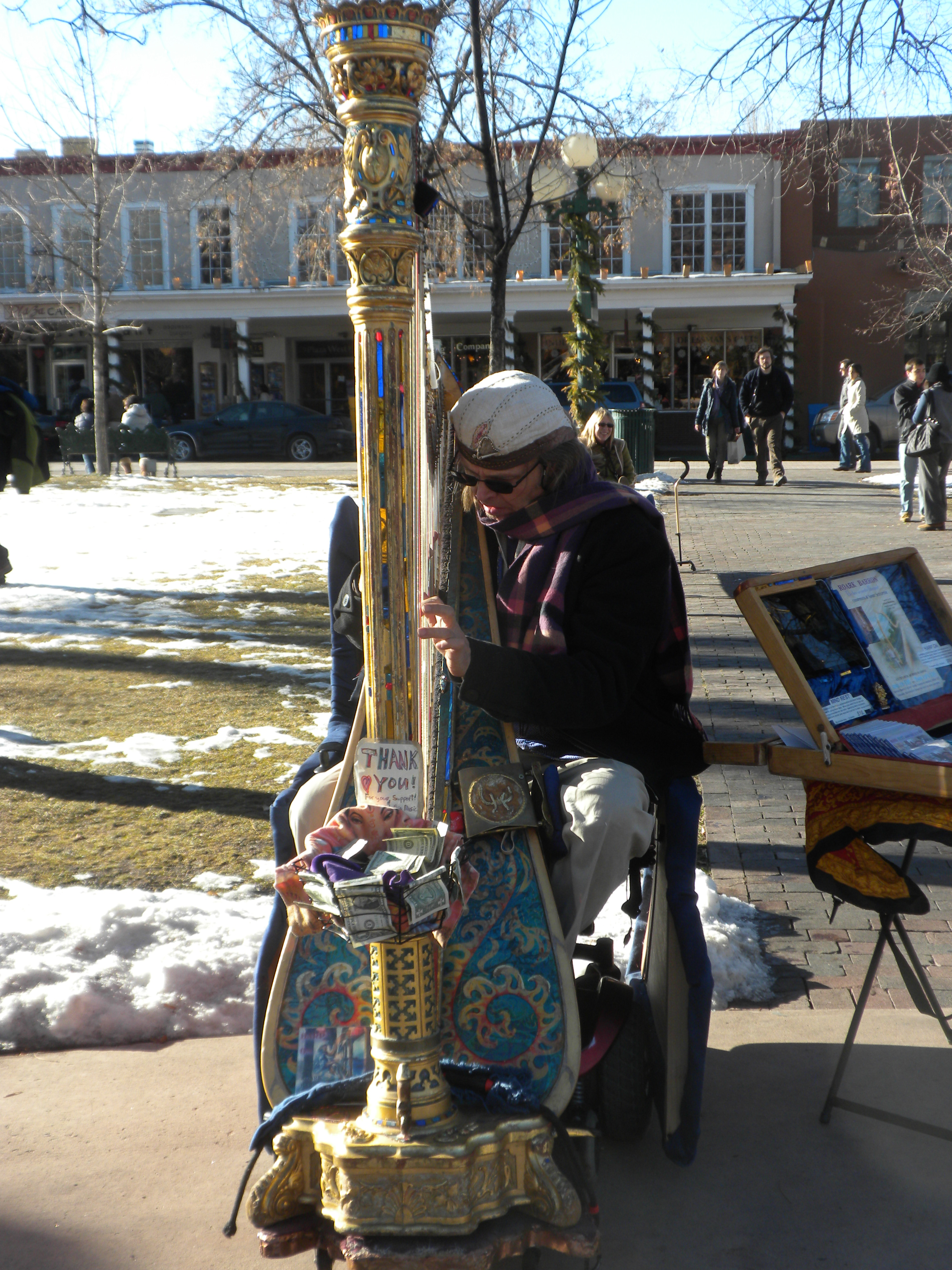 Wheelchair harp player on the Plaza