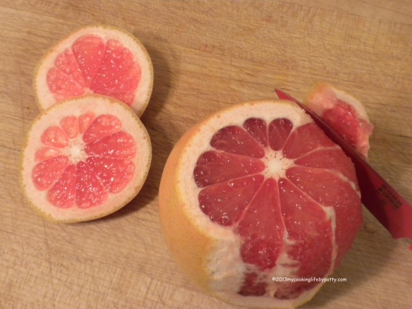 "First ""supreme"" the grapefruit by removing the top and bottom and then carefully slicing away the sides."