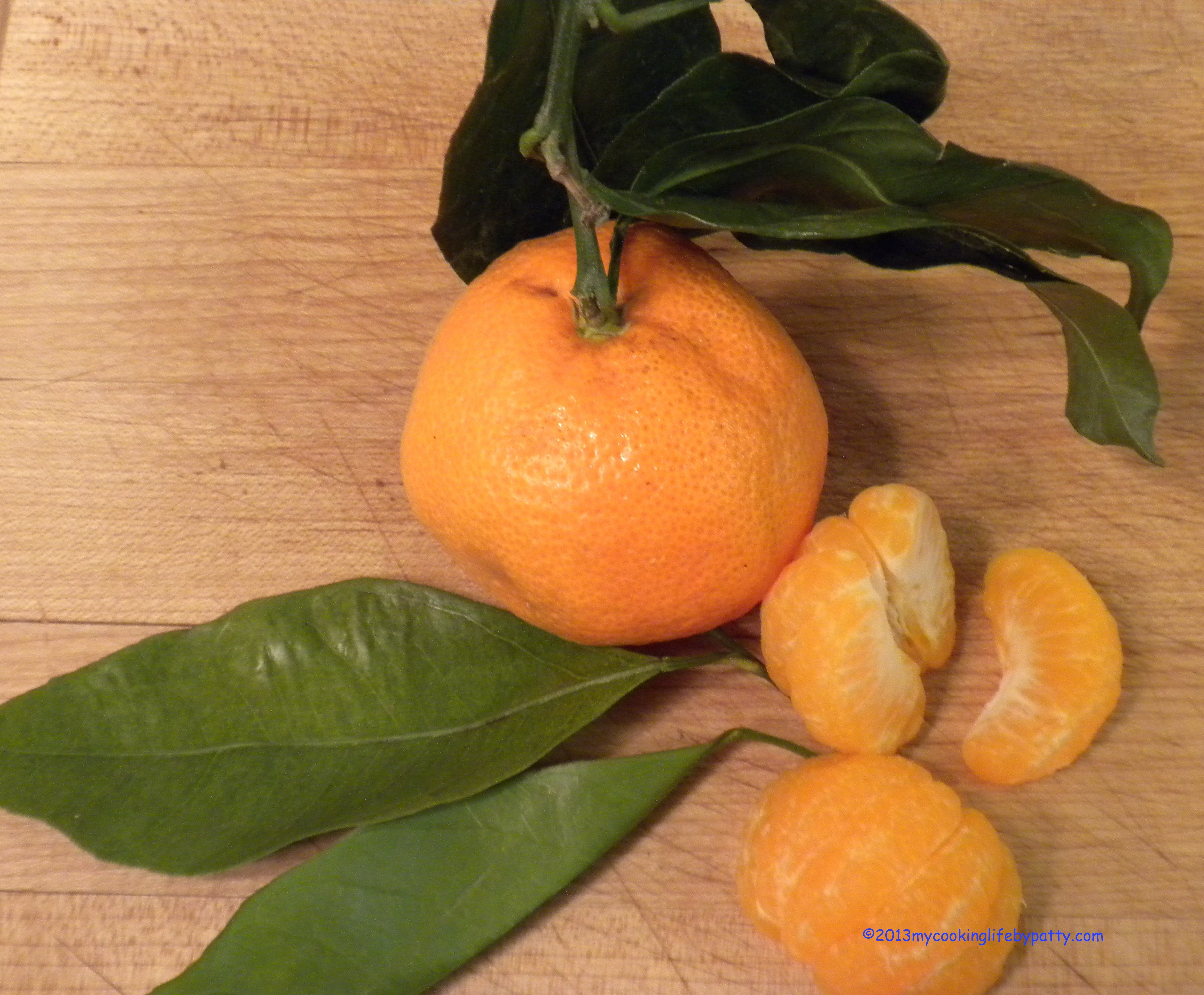 Now peel the tangerines, removing all the white pith. I used Satsuma tangerines which separate very easily from their skin.