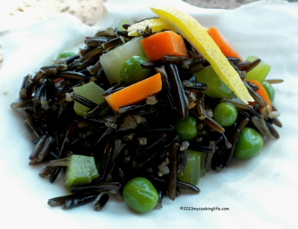 Wild rice salad with celery, carrots and peas.  Dressed with a white miso, walnut oil, lemon dressing.
