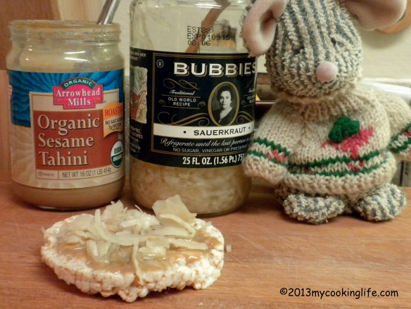 Claude loves rice cakes with toasted sesame tahini and sauerkraut. Moi aussi, Claude, me too!