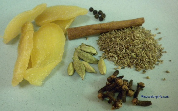 (Clockwise from the left) ginger slices, peppercorns, cinnamon stick, anise seeds, cloves and cardamom pods.